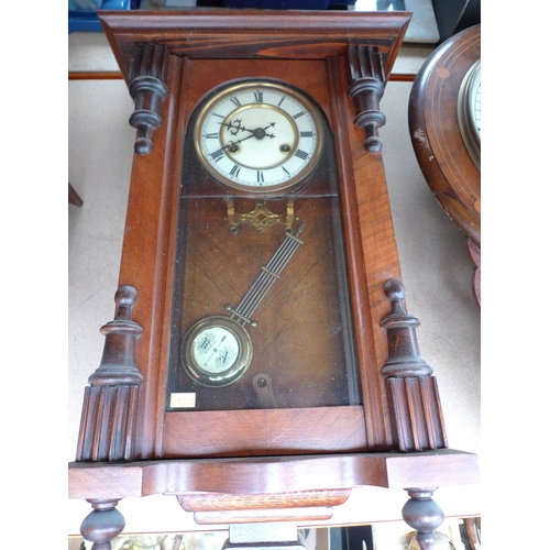 245 - A mahogany cased Vienna wall clock, eagle surmount, with pendulum, 87cm....