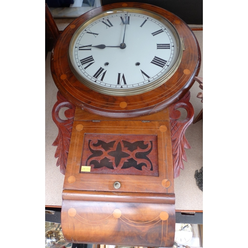 246 - A wall clock with twin train movement, inlaid circular case with glazed door below, 74cm....