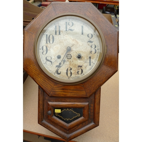 224 - An octagonal cased wall clock, silvered dial, glazed door below, twin train movement, with pendulum,...