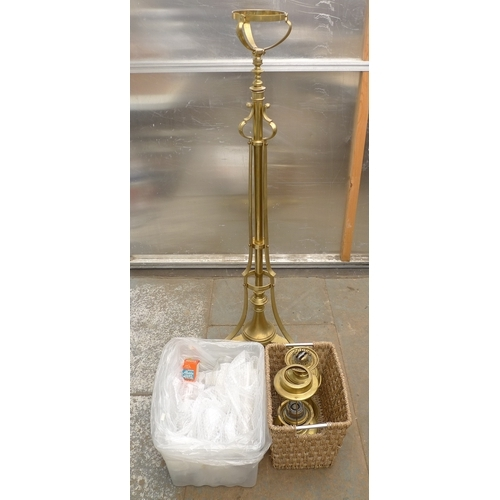 253 - A brass standard lamp, with telescopic top and tripod stand, complete with oil lamp and a further la...