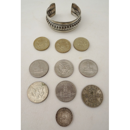 269 - A vintage silver cuff bracelet, together with a small selection of vintage British and American coin...