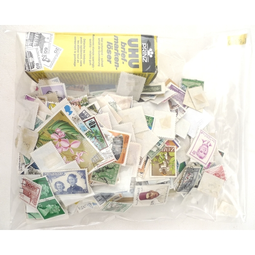 275 - A collection of mostly 20th century world stamps including a mint 1949 1500 Chinese stamp, together ...