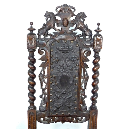 301 - A pair of Jacobean style side chairs, early 20th century, with carved crest backs, barley twist supp...