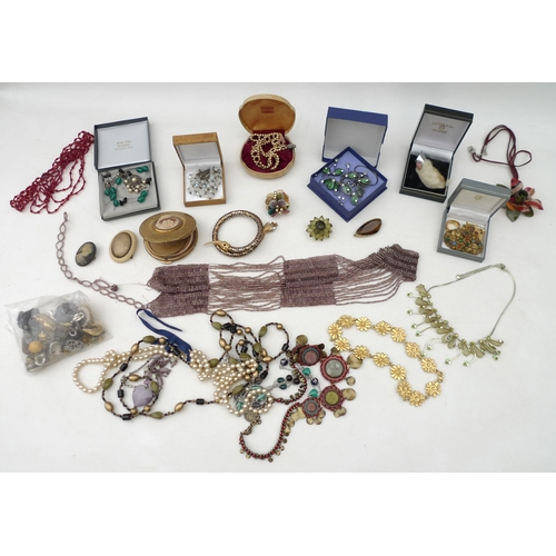 277 - A group of vintage and later costume jewellery, including various necklaces, brooches, bracelets, ea...