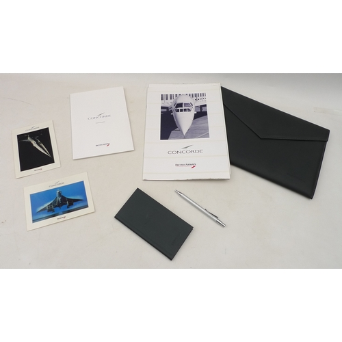 280 - A collection of Concorde memorabilia including a grey faux leather A4 wallet, a notepad, a pen, post...