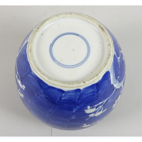 281 - A Chinese porcelain ginger jar, decorated in underglaze blue with prunus blossom against a cracked i...
