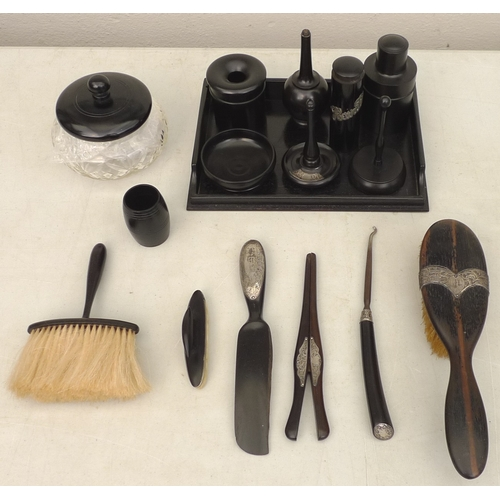 284 - A collection of Victorian turned ebony dressing table items, several with silver mounts, including a...