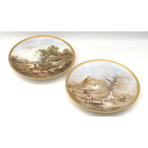 285 - A pair of late Victorian porcelain chargers, each hand painted with a pastoral scene, one of figures...