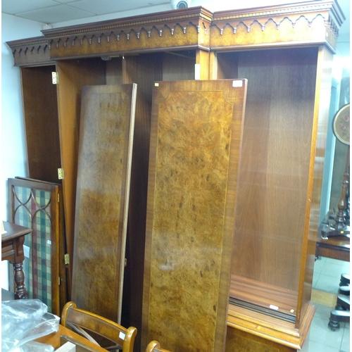 306 - A reproduction Georgian style breakfront wardrobe, two door full length hanging, four shelves flanke...