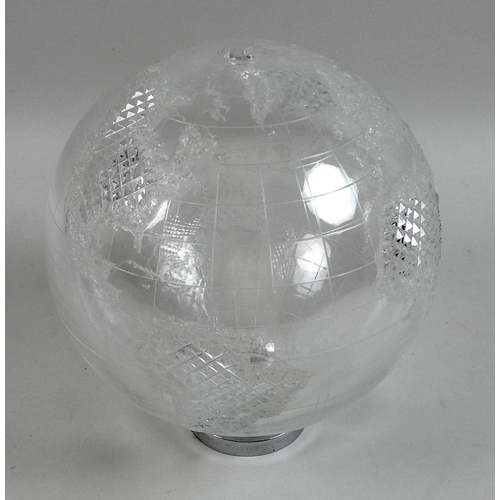 297 - A Waterford crystal globe, initialled JC, on partial stand....