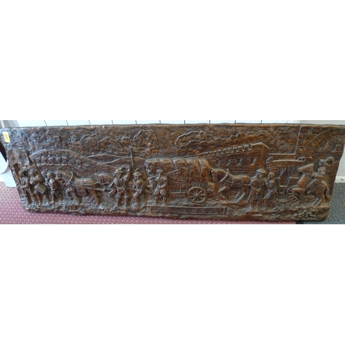 300 - A bronze effect plaster wall plaque, cast in relief depicting a merchant train in Germany, titled 'K...