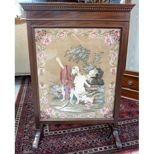 342 - A late 19th or early 20th century glazed firescreen with needlepoint embroidered panel, 65 by 29 by ...