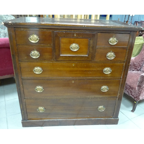 343 - An Edwardian mahogany veneered chest of seven drawers with reeded sides, and brass lockplates and ha...