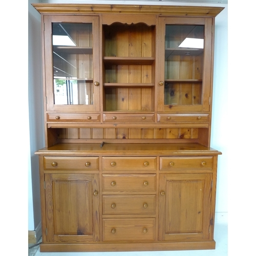 349 - A pitch pine dresser, 20th century, with open shelves flanked by glazed cupboards, the base with six...