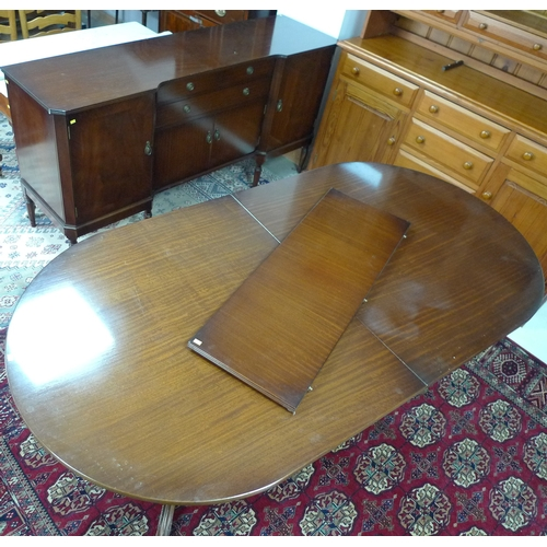 351 - A Strongbow Furniture dining suite, circa 1970, mahogany veneered, comprising sideboard, extending d...
