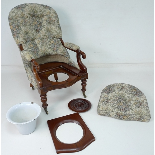 312 - A Victorian Spademan of Stamford mahogany commode in the form of a nursing chair, upholstered seat c...