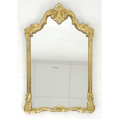 316 - A giltwood wall mirror, late 19th / early 20th century, with shaped plate and carved frame, 52 by 84...