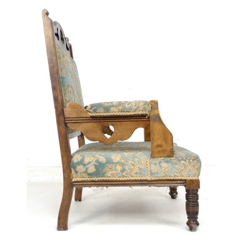 357 - A Victorian mahogany armchair, with pierced shaped back and the arms pierced with heart motifs, pale...