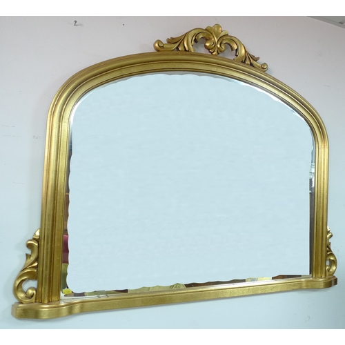 320 - A gilt framed over mantle mirror....