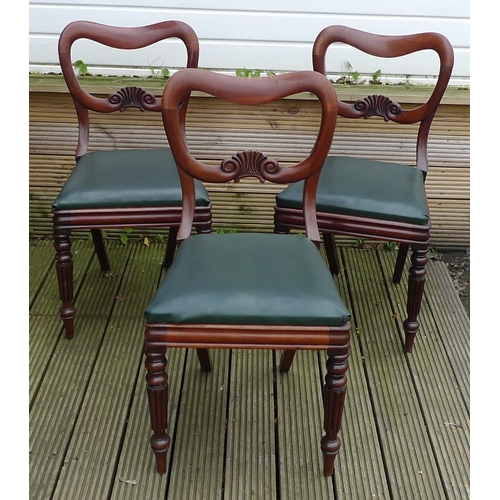 324 - A group of three Victorian mahogany dining chairs, with shaped open backs and green drop in seats, t...