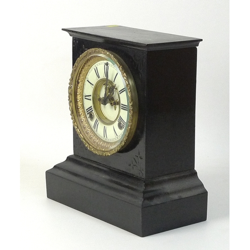325 - A slate mantel clock with visible escapement, Ansonia movement, and black Roman numerals, 25cm high....