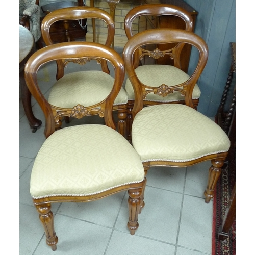 335 - A set of four reproduction balloon back dining chairs with cream upholstered seats....