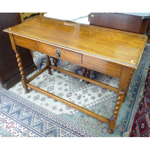 368 - An oak mid 20th century side table, rectangular surface with moulded edge, four barley twist support...