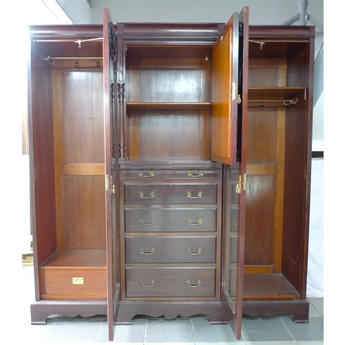 384 - An Edwardian mahogany compactum wardrobe, labelled John Reid & Sons, Leeds, with applied carved deco...