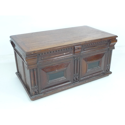 385 - An 18th century and later oak panelled blanket chest, some parts Victorian, the hinge plates to the ...
