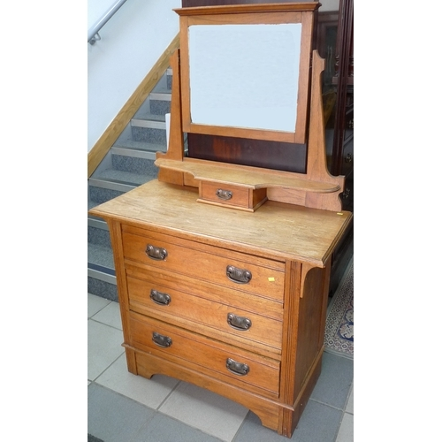 386 - An Edwardian oak dressing chest, mirror over three drawers....