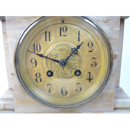 373 - A soapstone mantel clock, brass dial with Arabic numerals, 27cm high....