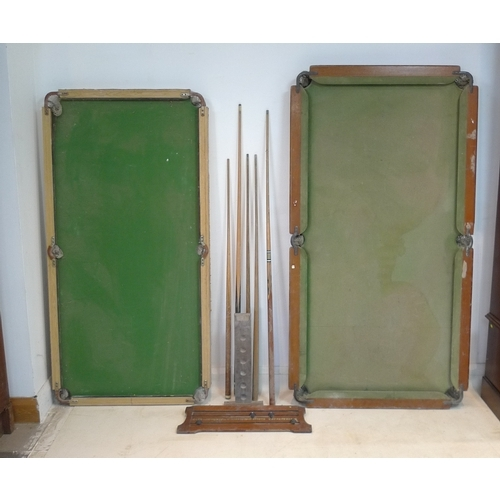 389 - Two snooker table tops, each without bases, a vintage wooden score board, five cues and a wooden cue...