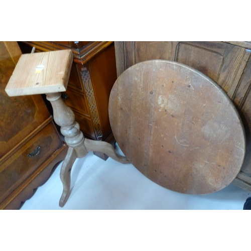 426 - A light pine circular tilt top table with tri-footed pedestal stem....
