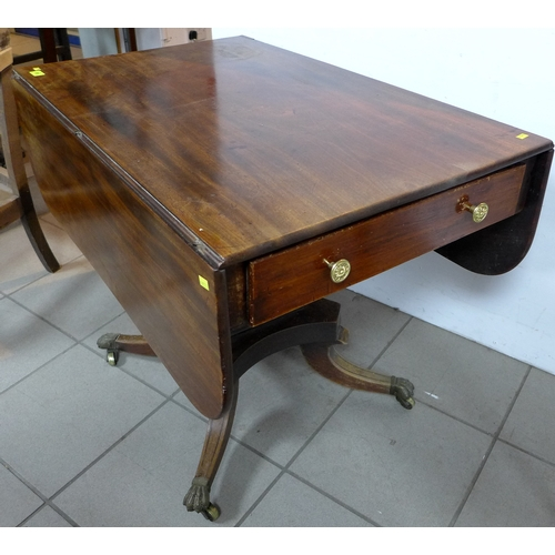 126 - A Regency style mahogany pembroke table, single drawer with brass knobs, raised on square section co...