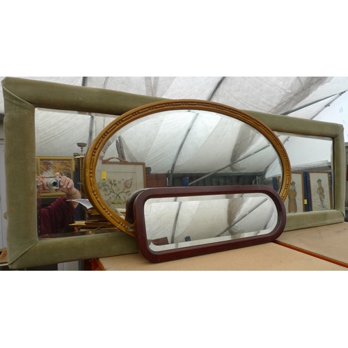 479 - A group of three wall mirrors, one oval with gilt frame, one with green dralon frame and the third w...