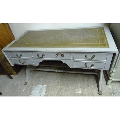 136 - A grey painted Regency style desk, with green leather surface, five drawers, and small drop leaves....