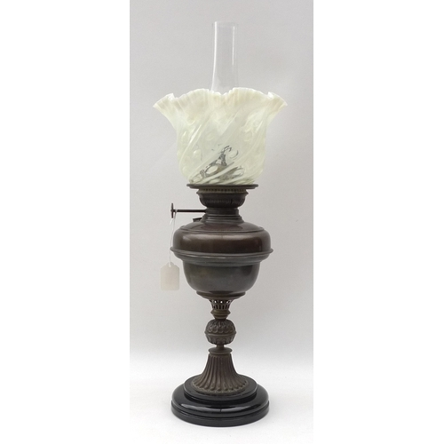 69 - A Victorian oil / paraffin lamp, with copper reservoir, opalescent glass shade with twist body and f...
