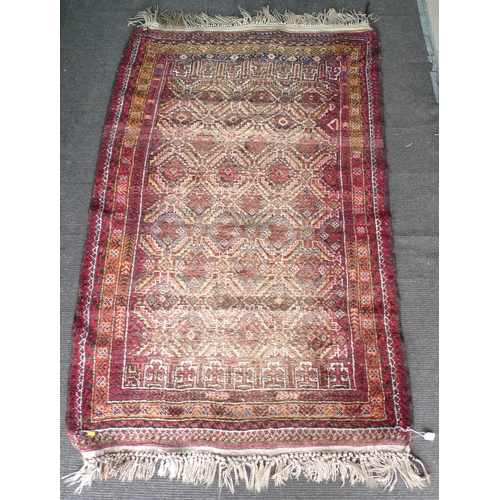 332 - A small Persian rug, with red ground, four and two half rows of repeating geometric medallions, mult...