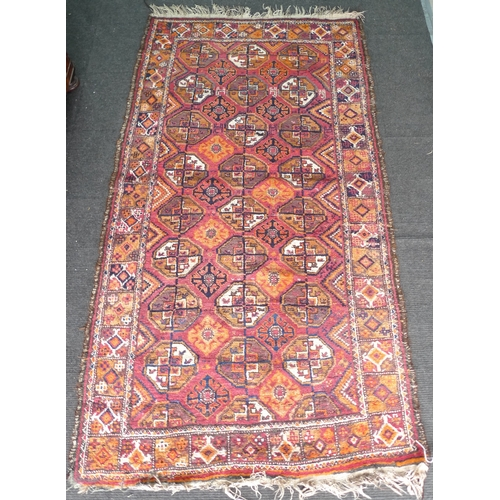 399 - A small Tekke rug with red ground, eight and a half rows of three guls, orange, brown, cream and dar...