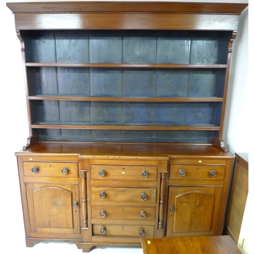 338 - An early 19th century mahogany Welsh dresser, wide cornice over a three shelf plate rack with the ba...