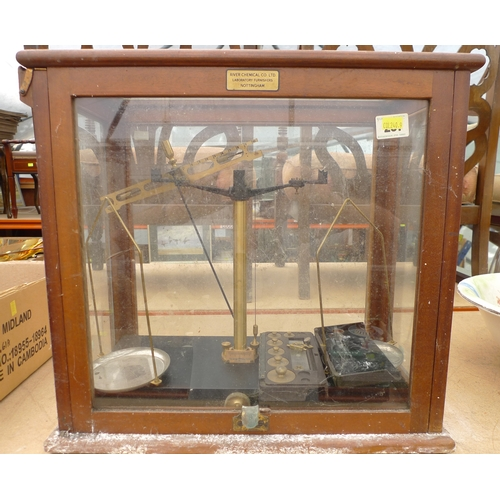 396 - A set of laboratory scales in five glass case, labelled River Chemical Co Ltd, Laboratory Furnishers...