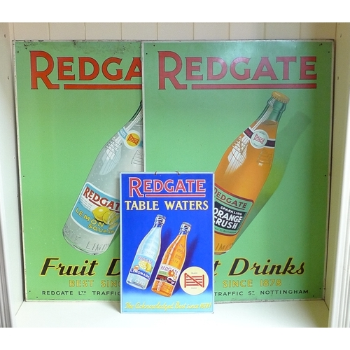 488 - A pair of vintage tin signs advertising Redgate Fruit Drinks, one depicting Orange Crush, the other ...