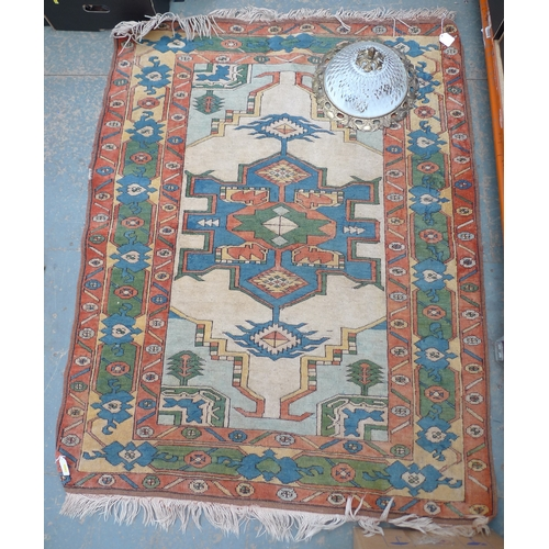 82 - A wool rug with multicoloured geometric ground, 155 by 118cm, together with a ceiling light, brass s...