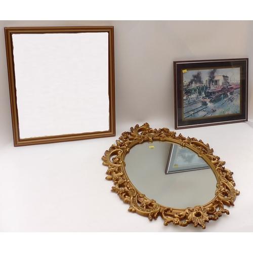 53 - A modern beige ground rug, a Victorian style oval mirror, a smaller rectangular mirror, and a Terren...