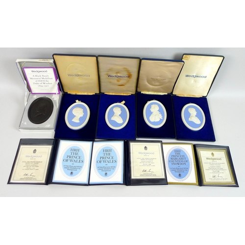 279 - A group of five Wedgwood oval portrait medallions, each of various members of the Royal family, some...