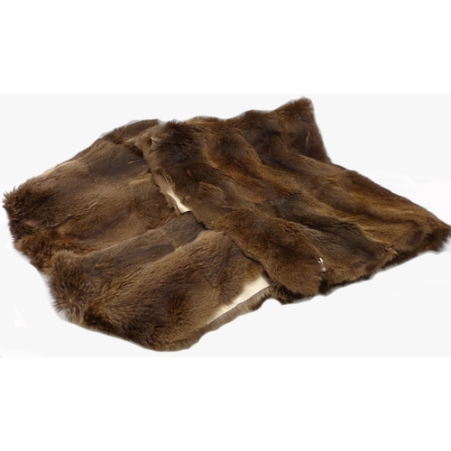 496 - Two mink rugs...