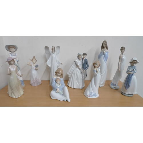 502 - A collection of Nao figurines, including 'The Greatest Bond' and 'Unforgettable Dance' figures. (1 b...