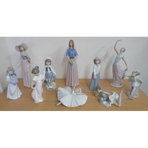 500 - A collection of Nao figurines, including a number of dancing figures such as 'The Dance is Over'. (1...