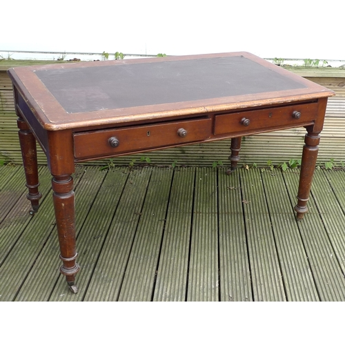 219 - A Victorian mahogany library table / desk, inset dark brown cloth surface, moulded edges, two frieze...