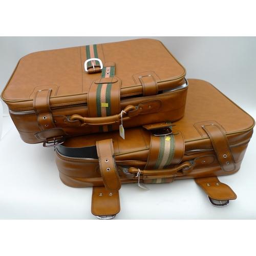 510 - A pair of vintage brown suitcases....